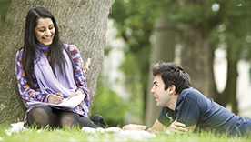 Students chatting on the grass
